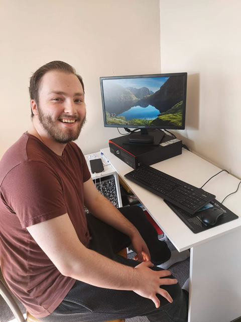 Sam Skill, Sales Agent at ResQ working from home.